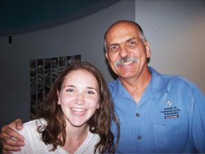 Dr. Ken and patient who recently got her braces off smiling | Grabowski Orthodontics